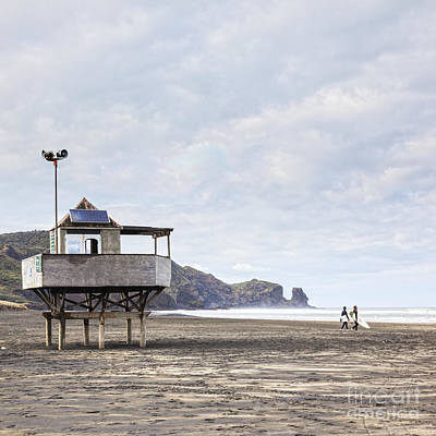 Lifeguard Tower And Surfers Bethells Beach New Zealand Poster by Colin and Linda McKie