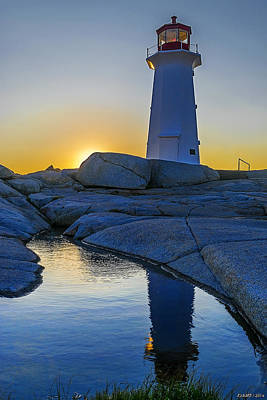 Lighthouse At Sunset Poster by Ken Morris