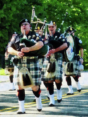 Line Of Bagpipers Poster by Susan Savad