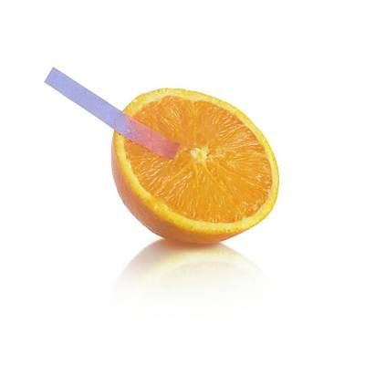 Litmus Paper Test On An Orange Poster by Science Photo Library