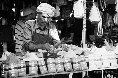 Local Arab Man Measuring Out A Quantity Of Spice For Sale On Stall Of Spices At The Market In Nabeul Tunisia Poster by Joe Fox