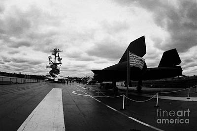 Lockheed A12 Blackbird On The Flight Deck Of The Uss Intrepid Poster by Joe Fox