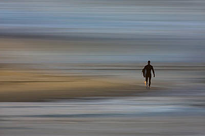Poster featuring the photograph Lone Surfing Walking A Surreal Shoreline by David Orias