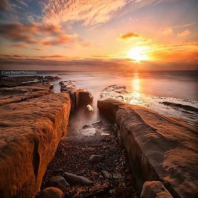 Long Exposure Sunset At A Rocky Reef In Poster by Larry Marshall
