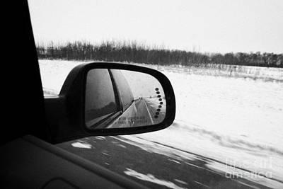 looking at side view mirror winter driving along Saskatchewan highway 11 from Saskatoon to Regina Ca Poster