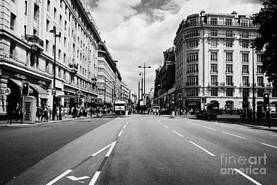 looking down oxford street from marble arch London England UK Poster by Joe Fox