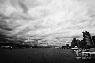 looking out from coal harbour into Vancouver Harbour on an overcast cloudy day BC Canada Poster by Joe Fox
