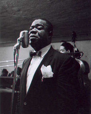 Louis Armstrong Stands In Front Of The Microphone Poster