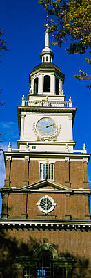 Low Angle View Of A Clock Tower Poster