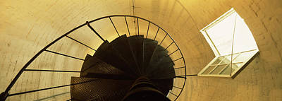 Low Angle View Of A Spiral Staircase Poster