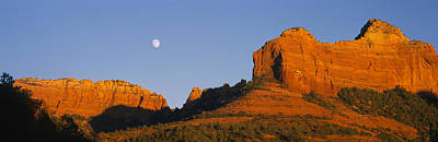 Low Angle View Of Moon Over Red Rocks Poster by Panoramic Images