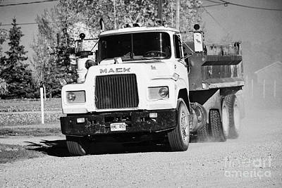 mack truck driving down rough unpaved rural road in farming community Saskatchewan Canada Poster by Joe Fox