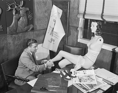 Man Adjusting A Mannequin Poster by Arthur S. Siegel