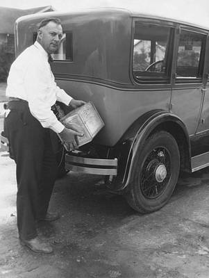 Man Filling Car With Fuel Poster by Underwood Archives