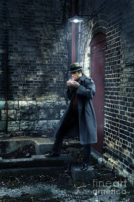Man In Trenchcoat Lighting A Cigarette Poster by Jill Battaglia