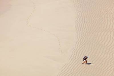 Man Leaving Footprints On Beach Poster by Ashley Cooper
