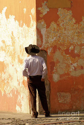 Poster featuring the photograph Man On The Corner Antigua Guatemala by John  Mitchell