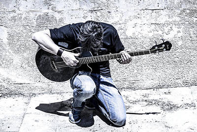 Man Playing Acoustic Guitar Kneeling Outside Poster