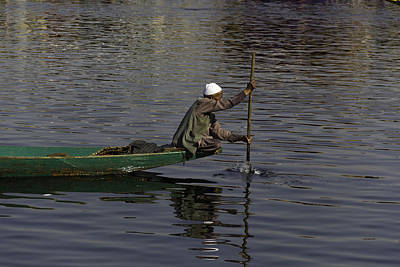 Man Plying A Wooden Boat On The Dal Lake Poster