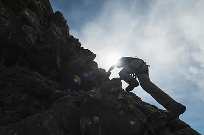 Man Scrambling Up Ridge In The Black Poster