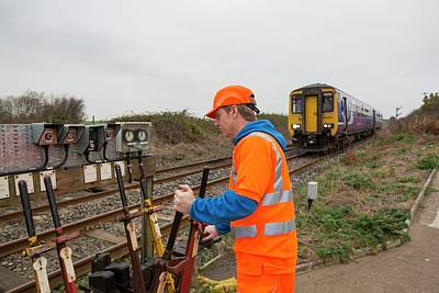 Man Switching Points At A Level Crossing Poster