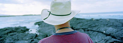 Man With Straw Hat Galapagos Islands Poster by Panoramic Images