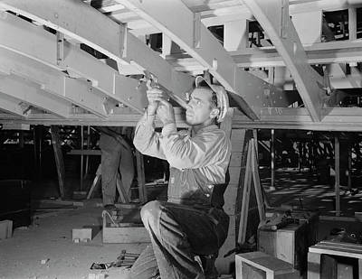 Man Working With A Chisel On A Beam Poster