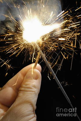 Man's Hand Igniting Sparkler Poster by Sami Sarkis