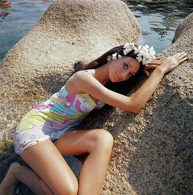 Marisa Berenson Posing On Rocks On The Sardinian Poster