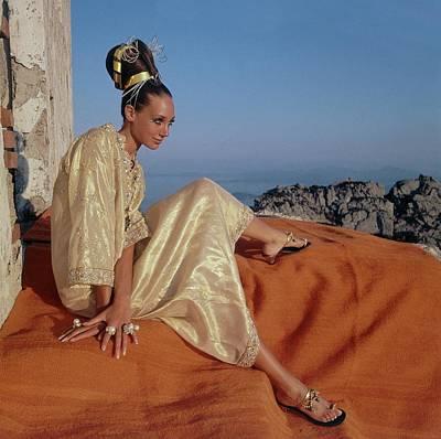 Marisa Berenson Wearing A Gold Caftan By Tina Poster