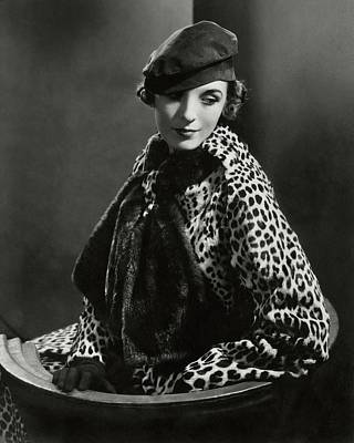Mary Oakes Wearing Revillon Freres On A Chair Poster