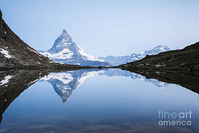 Matterhorn Reflected In Riffelsee Lake At Sunrise Poster by Matteo Colombo