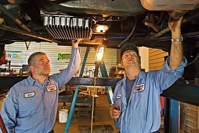Mechanics Repairing Recreational Vehicle Poster