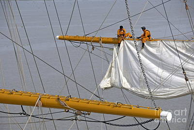 Men Repairing Sail Of Three-masted Sailboat Poster by Sami Sarkis