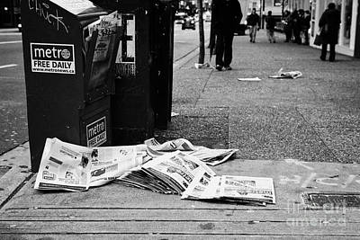 metro free newspapers thrown discarded on the sidewalk Vancouver BC Canada Poster by Joe Fox