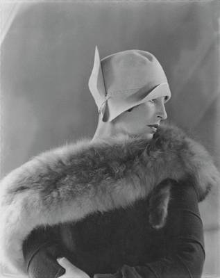 Model Halles Stiles Wearing A Cloche Hat And Fur Poster