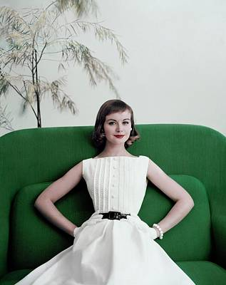 Model Phyllis Newell Sitting On A Green Sofa Poster