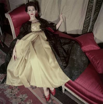 Model Reclining In An Evening Dress And Coat Poster