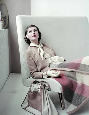 Model Sitting In Chair Wearing Plaid Skirt Poster