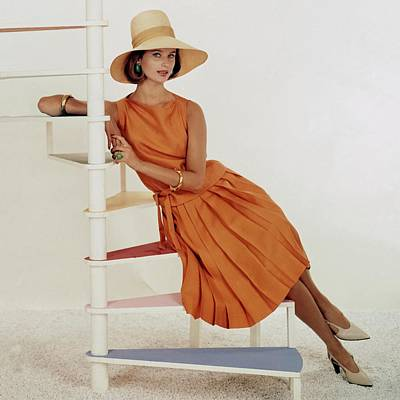 Model Sitting On A Spiral Staircase Poster