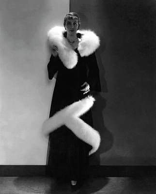 Model Wearing A Black Coat With Fur Trim Poster