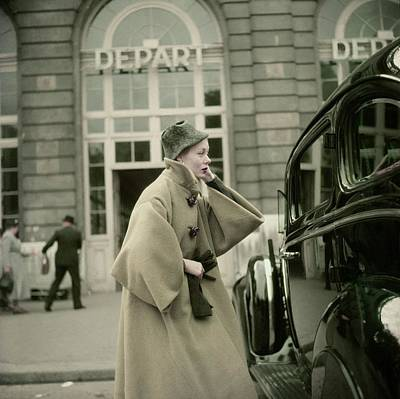 Model Wearing A Coat By Griffe Poster