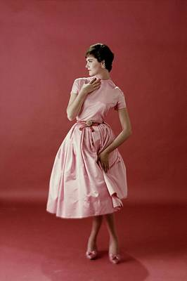 Model Wearing A Pink Satin Dress Poster