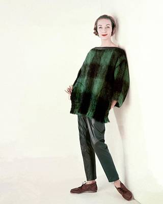 Model Wearing A Plaid Sweater And Leather Pants Poster