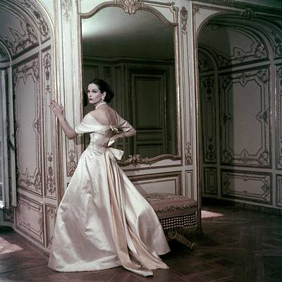 Model Wearing A Satin Evening Dress By Griffe Poster