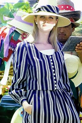Model Wearing An Emme Hat Poster