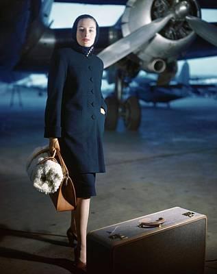 Model Wearing Ceil Chapman Coat At Airport Poster