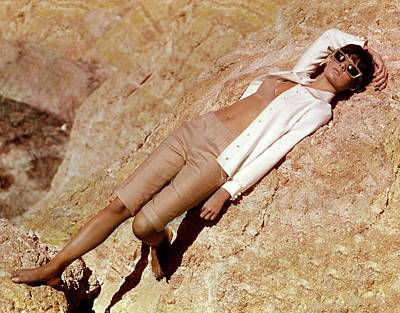 Model Wearing Claret Clothing In A Desert Poster by William Connors