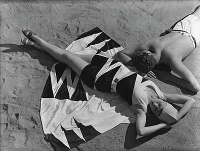 Models Lying On A Beach Poster