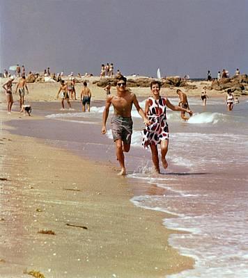 Models Running On A Beach Poster